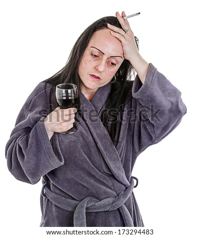 Addiction, woman drinking red wine and smoking, wearing dressing gown. - stock photo