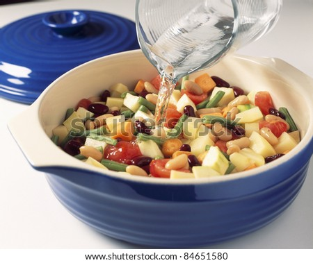 Adding the water and boil - stock photo