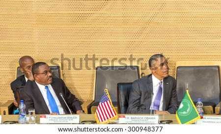 Addis Ababa - July 28: President Obama and Prime Minister Hailemariam Desalegn attentively listen to the speech of Dr. Dlamini Zuma, Chairperson of the AUC, on July 28, 2015, in Addis Ababa, Ethiopia. - stock photo
