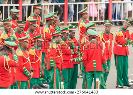Addis Ababa - May 5: Men, Women and Children in colourful uniforms attend the 74th anniversary of Patriots' Victory day  on May 5, 2015 in Addis Ababa, Ethiopia. - stock photo