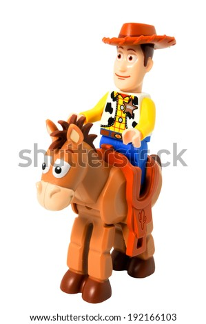 ADELAIDE, AUSTRALIA - April 14 2014:A studio shot of a Woody and bullseye Lego minifigure from the Disney movie series Toy Story. Lego is extremely popular worldwide with children and collectors. - stock photo