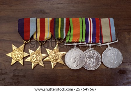ADELAIDE, AUSTRALIA - APRIL 2, 2014: Original Australian Army World War II medals with the 1939 - 1945 Star, Africa Star, Pacific Star, Defence Medal, 1939 -1945 Medal and Australian Service Medal. - stock photo