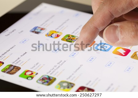 Adelaide, Australia - September 23, 2013: Browsing the App Store on an ipad running iOS. iOS 7 is the foundation of iPhone, iPad, and iPod touch. It comes with a collection of apps and useful features - stock photo