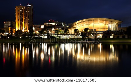 Adelaide Skyline with a reflection in the waters of the Torrens River - stock photo