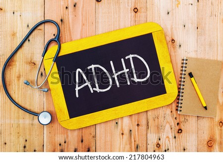 ADHD handwritten on blackboard , medecine concept. - stock photo