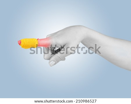 Adhesive Healing plaster on finger. Pain concept photo. - stock photo