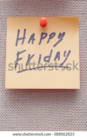 Adhesive note with Happy Friday text on a cork bulletin board - stock photo