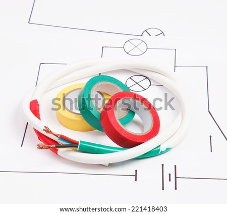 Adhesive plastic tape and electric cable on a background of the electric scheme - stock photo