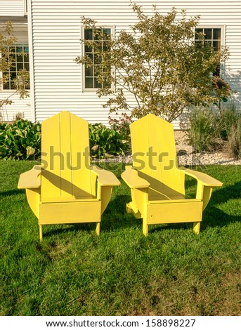 Adirondack chair beach view - stock photo