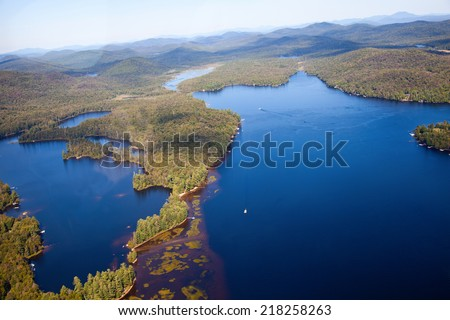 Adirondack forests and lakes summer aerial view from light aircraft cabin - stock photo
