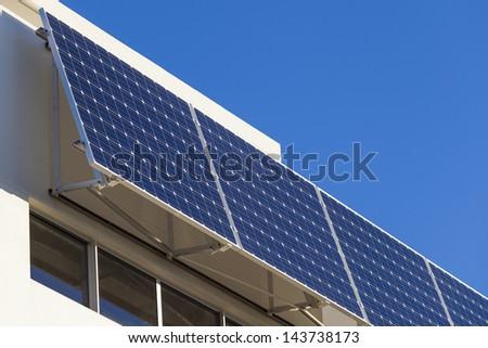 Adjustable solar panel installation on luxury home - stock photo