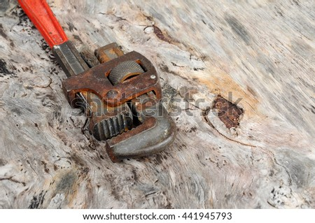 Adjustable wrench on wood grain background.    - stock photo