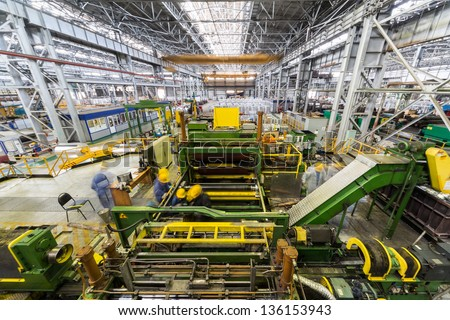 Adjustment of complicated machine for aluminum rolling. - stock photo