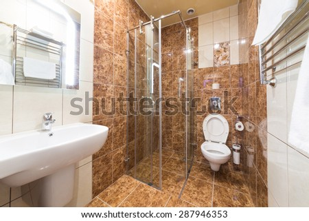ADLER, RUSSIA - JULY 22, 2014: Interior bathroom of a hotel room with glass shower in Shine House hotel - stock photo
