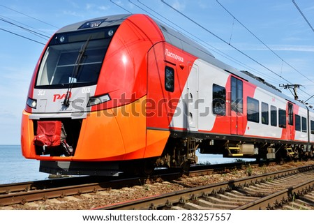 ADLER, SOCHI, RUSSIA - MAY 17, 2015: High speed train Lastochka in a spring day. Produced by Siemens AG, the train can reach speeds up to 160 km/h - stock photo