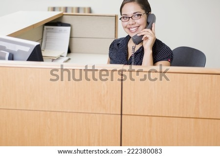 Administrative Assistant Answering the Phone - stock photo
