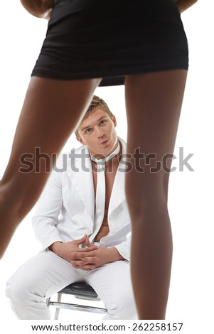 Admiring young guy stares at sexy girl - stock photo