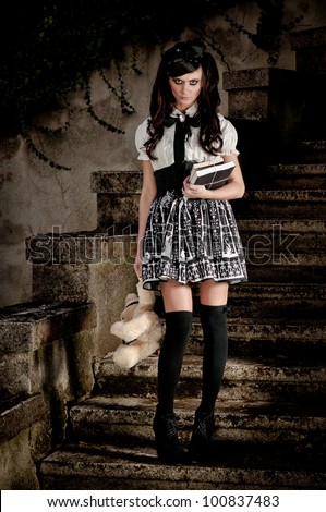 Adolescent beautiful Lolita schoolgirl looking forlorn and insecure as she exudes an air of precocious sexuality - stock photo