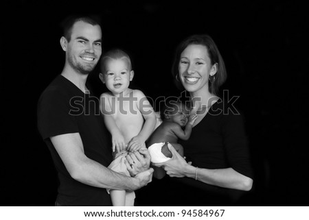 Adopted newborn with family - stock photo