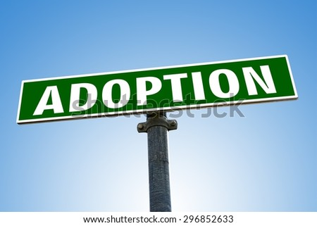 ADOPTION word on green road sign - stock photo