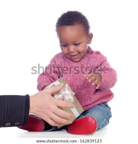 Adorable African American child playing with a gift box isolated on a white background - stock photo