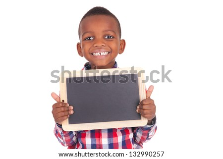 Adorable african little boy  with slate - stock photo