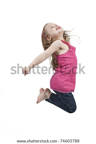 Adorable and happy little girl jumping in air. isolated on white background - stock photo