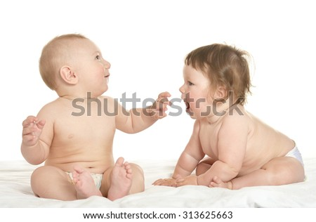 Adorable babies  on blanket on a white background - stock photo