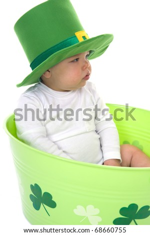 Adorable baby boy dressed for St. Patrick's Day in the studio - stock photo
