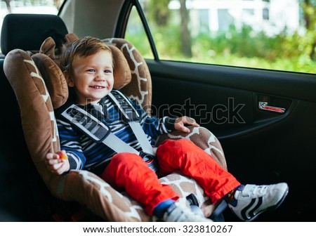 Adorable baby boy in safety car seat.  - stock photo