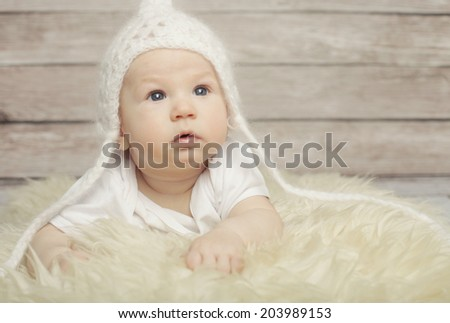 Adorable  baby boy in white hat - stock photo
