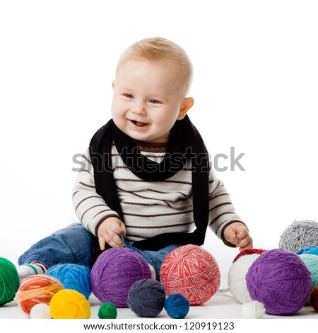 Adorable baby boy in winter clothes - stock photo
