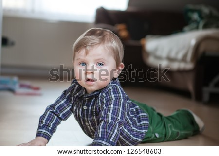Adorable baby boy learning crawling indoor - stock photo