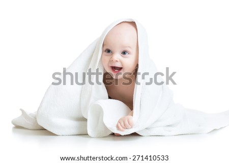 Adorable baby boy looking out under white towel - stock photo