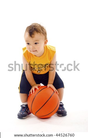 Adorable baby  boy playing with a basketball isolated over a white background - stock photo