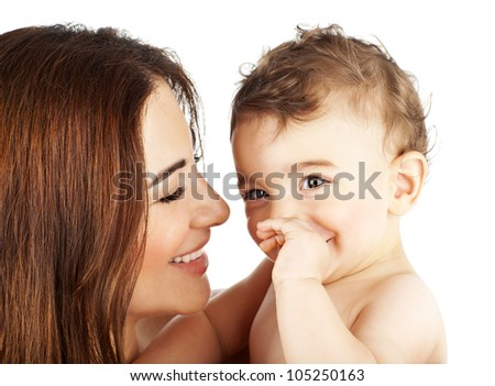 Adorable baby boy smiling with mother, closeup on happy family faces, mom and kid having fun indoor, parent holds little child in hands, healthy toddler and mommy portrait isolated on white background - stock photo