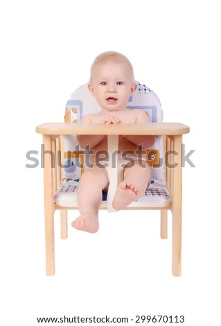 Adorable baby boy waiting for food his chair isolated on white - stock photo