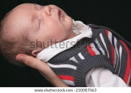 Adorable  baby boy with blue eyes in front of a white background - stock photo