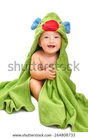 Adorable baby boy wrapped in a green hooded baby towel, looking at camera with a happy and excited expression, isolated on white - stock photo