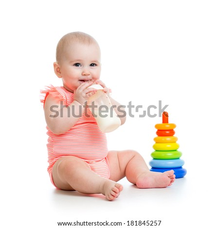 adorable baby girl drinking milk from bottle - stock photo