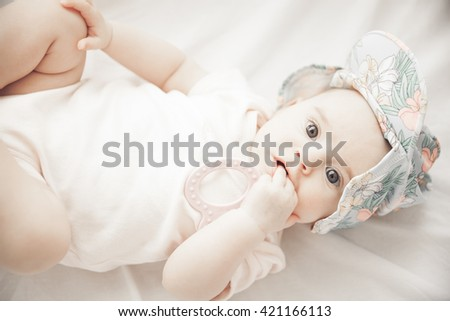 adorable baby girl holding a hand in the mouth isolated on white background. Horizontal. Shallow doff - stock photo