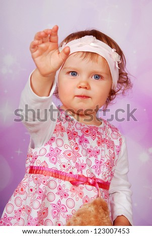 adorable baby girl in dress waving hand - stock photo