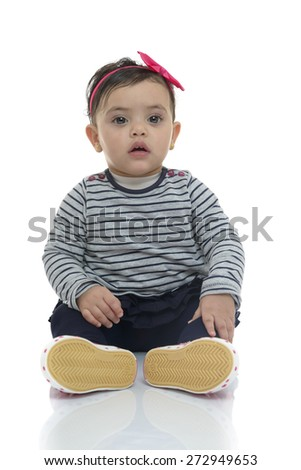 Adorable Baby Girl Looking at Camera Isolated on White Background - stock photo
