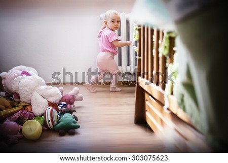 Adorable baby girl made a lot of mess, caught red handed - stock photo