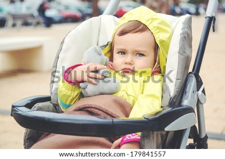 Adorable baby girl outdoors. Image with an instagram effect - stock photo