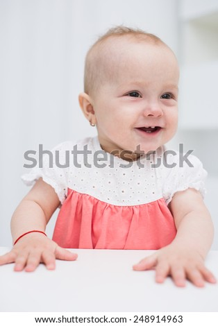 adorable  baby girl playing at home - stock photo