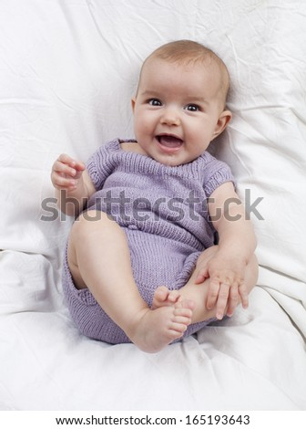 adorable baby girl relaxing - stock photo