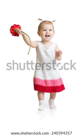 Adorable baby girl walking with flower isolated - stock photo
