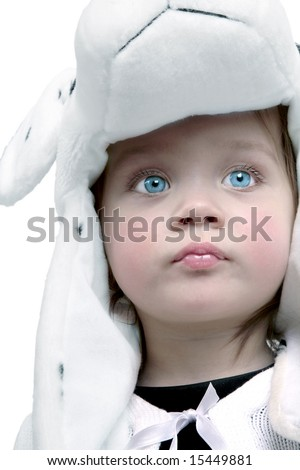 Adorable baby girl wearing fuzzy hat with bright blue eyes - stock photo