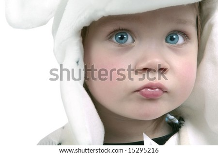 Adorable baby girl wearing white fuzzy hat - stock photo